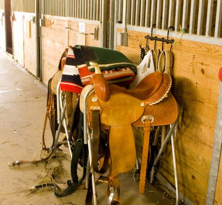 General view of saddles and paraphenalia at stables.