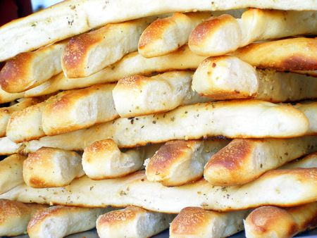 bountiful: Stacks of bread sticks at pizza vendor at an outdoor event. Stock Photo