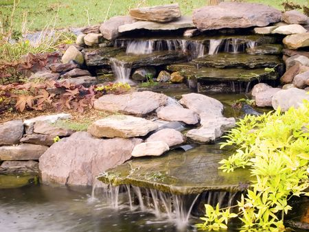 water feature: Photograph of a decorative water feature in a garden.