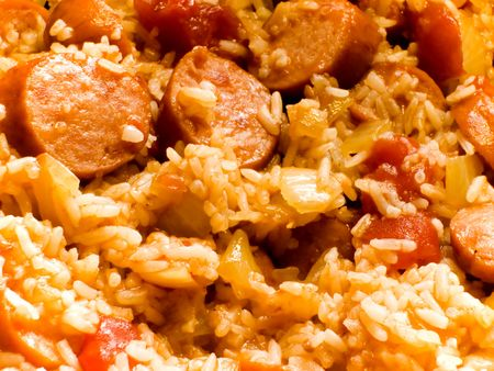 Creole-style smoked sausage jambalaya with tomatoes, onions, peppers, and rice Stok Fotoğraf