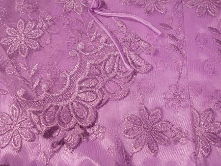 shiney: Detail of a lavender Oriental blouse sleeve with floral lace overlay with shiney threads woven through it. Stock Photo