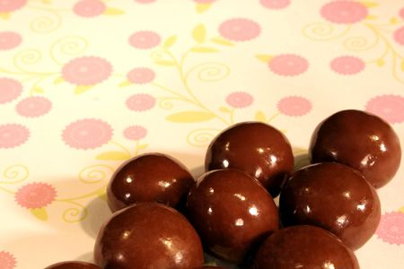 malted: Malted Milk Balls candy on a colorful floral background.