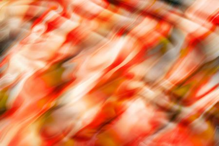 variegated: Red, white, and black blurred and rippled abstract image for backgrounds or wallpaper.