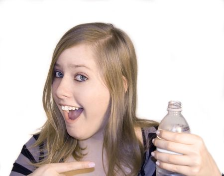 Teen girl pointing to a bottle of water with a white background. photo