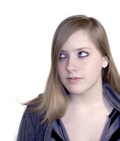 Teen girl rolling her eyes on a white background. Stock Photo - 703272