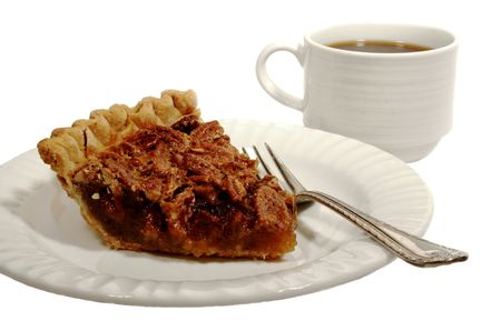 Pecan pie with a golden brown crust with a cup of coffee isolated on white.