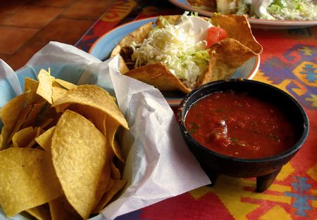 chips and salsa: Tortilla chips, salsa, and taco salad at a Mexican restaurant. Stock Photo