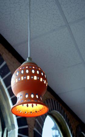 Hanging light fixture at a Mexican restaurant. Banco de Imagens
