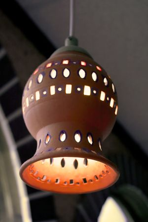 fixture: Hanging light fixture at a Mexican restaurant. Stock Photo