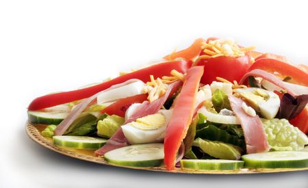 Close up view of a Chef's Salad artfully arranged on a gold-tone platter. Stock Photo - 768728