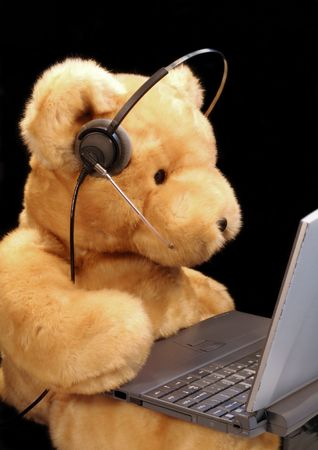 A teddy bear prepared for customer service or to chat on the phone or online. photo