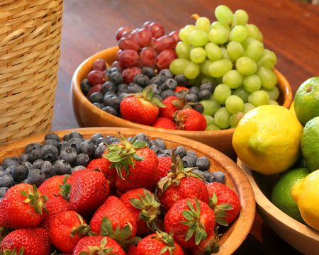Various Types of Fruit Arranged and Displayed in Wooden Bowls and Baskets. Stock Photo - 842347