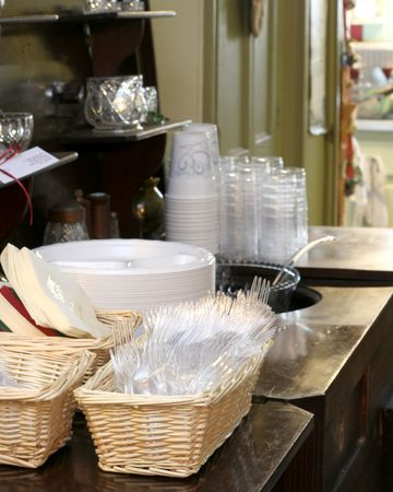 Plastic Flatware and Cups Arranged in Preparation for a Buffet Style Dining Event. Stock Photo - 842345
