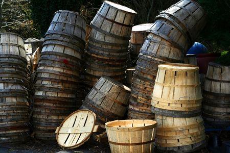 bushel: Used and new bushel baskets stacked behind a seafood market. Stock Photo