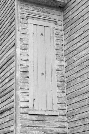 shutter: Old shutter covering a window in a very old building.