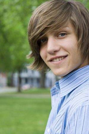 Outdoor spring portrait of a teenaged boy and a bench. Stok Fotoğraf