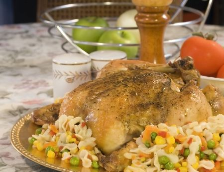 shiney: Roasted Chicken on a platter with mixed vegetables and pasta. Stock Photo