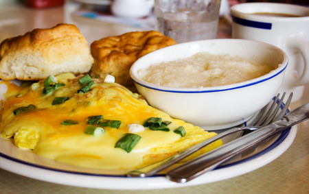 satisfying: Cheese Omelet Breakfast with Onions and Hollandaise Sauce