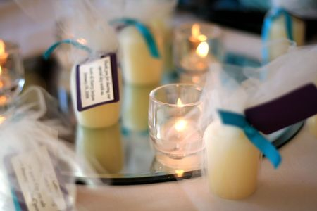 An arrangement of votive candles on a mirror as a centerpiece decoration for a wedding reception. Stock Photo - 2525694
