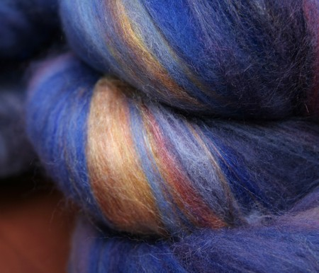 Close up view of details of hand dyed and hand blended wool fibers ready for spinning or felting.