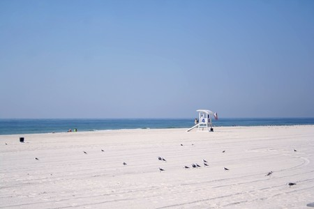 Scene from Beach at Gulf Shores, Alabama, USA, at end of summer with Life Guard Stand.