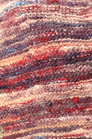 Close up view of hand dyed, hand spun, hand knitted wool.