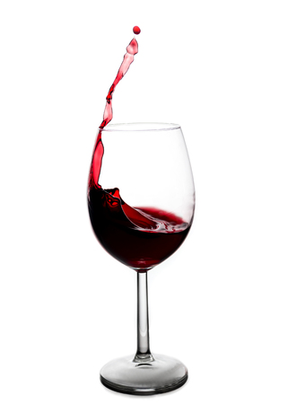 splash of red wine in a glass on a white background Stock Photo