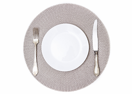 Empty plate and cutlery. Plate, fork and knife. Silverware and a