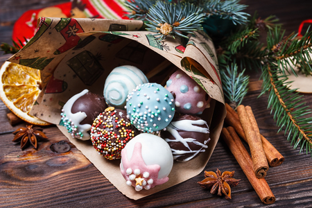 Cake pops isolated on wooden background.