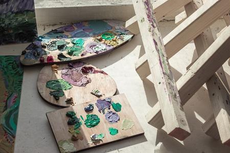 Artistic equipment. Oil paints. Paint brushes. Retro toned.