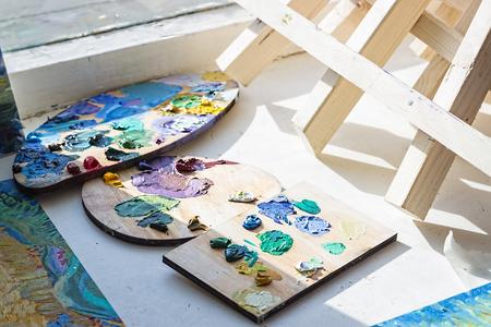 Artistic equipment. Oil paints. Paint brushes. Retro toned photo.