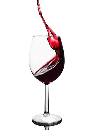 splash of red wine in a glass on a white background Reklamní fotografie