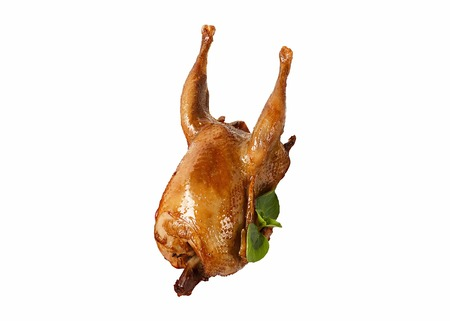 Baked quail isolated on white background. Green basil. Stock Photo