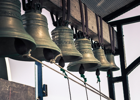 Set of church bells. Toning photo in retro style.