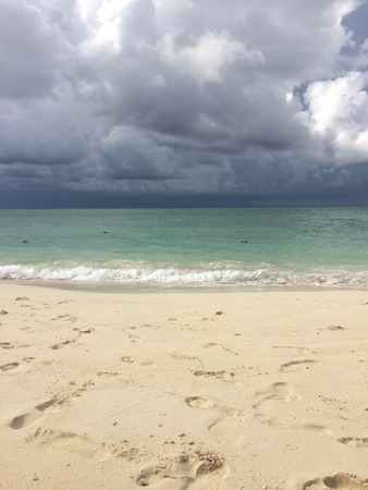 storm coming: storm coming in over ocean on tropical island