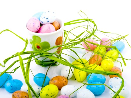 Lots of easter eggs on white background. photo