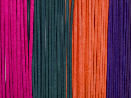 Colorful incenses background photo