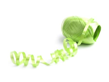 hank: Hank of green ribbon on white background