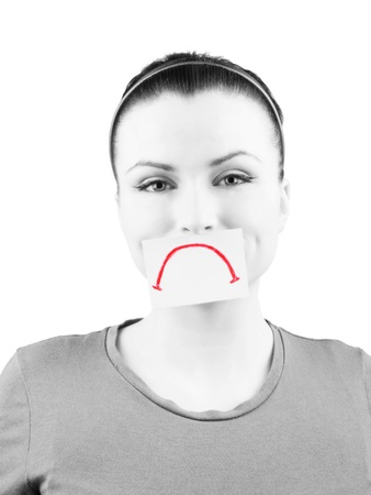 Portrait of happy woman with fake unhappy face, on white background photo