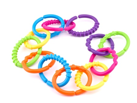 teether: Picture of colorful teething rings on white background.