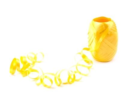 hank: Hank of yellow ribbon on white background