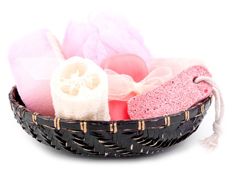 tratment: Bath and spa accessories in black basket on white background Stock Photo