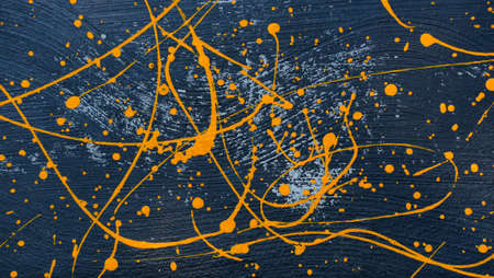 abstract oil color yellow color splatter paint on dark blue texture background. color paint texture background design 版權商用圖片