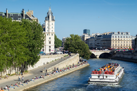 european culture: People are enjoying their free time on the banks of river Seine in Paris, France