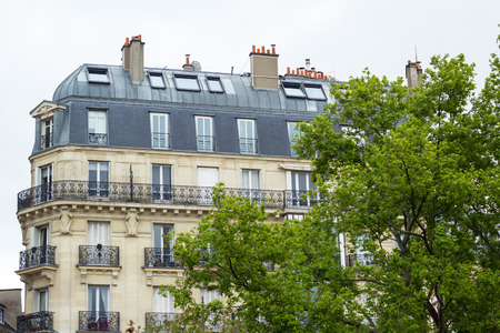grey  sky: Classic Parisian building under grey sky Editorial