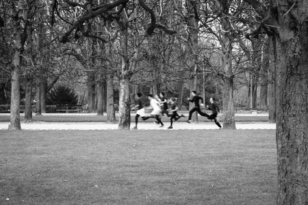 du: A group of children are running in the Jardin du Luxembourg in Paris, France Stock Photo