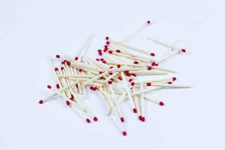 dozens: Stack of dozens of matchsticks on white background Stock Photo