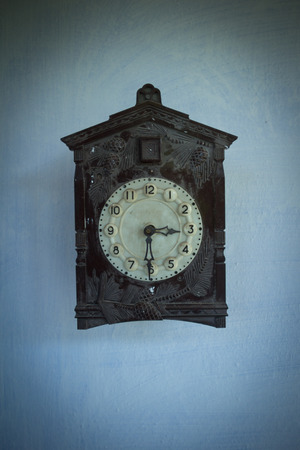 horologe: Antique cuckoo clock on wall Stock Photo
