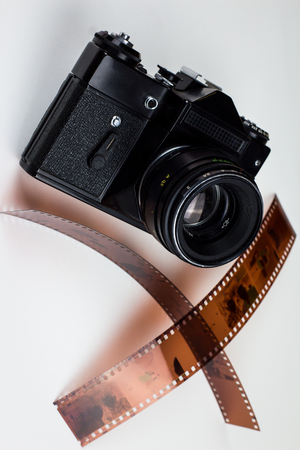 analogue: Analogue film photo camera with two filmstrips Stock Photo