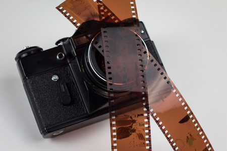 analogue: Analogue film photo camera with two filmstrips over lens Stock Photo